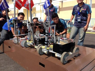 UTM teams with their Conquer Robot after the competition