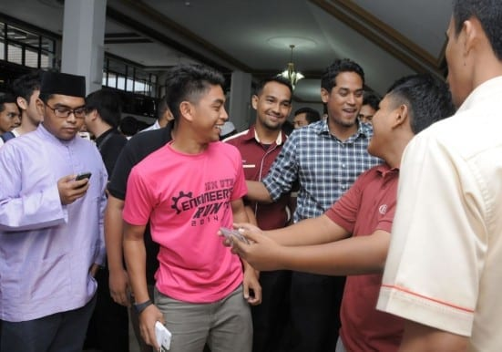 Khairy having some light moments with UTM student before leaving the Senate Hall