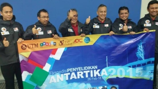 Prof Mazlan (third left) and other researchers holding a banner about the UTM Antarctica Research Expedition 2015