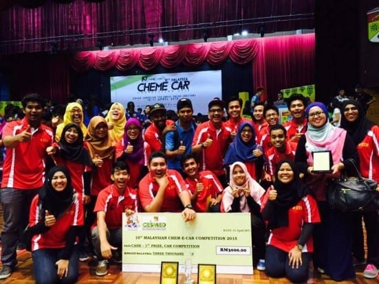UTM teams posing with their winning awards at Chem-E-Car Competition 2015 held at DCTAR, Universiti Kebangsaan Malaysia (UKM).