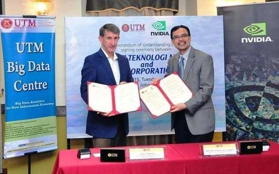 Prof. Azlan (right) and Marc Hamilton showing the agreement documents after the signing ceremony held at Dewan Sultan Iskandar , Johor Bahru campus