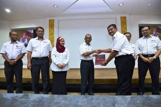 Prof. Wahid giving the certificate of appointment as UTM Security Director to Abd Rahim Abd Karim, newly appointed Director of UTM Security Division.
