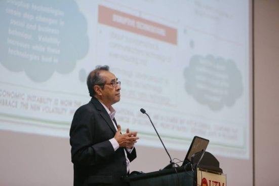 Datuk Hamzah delivering speech at UTMKL.