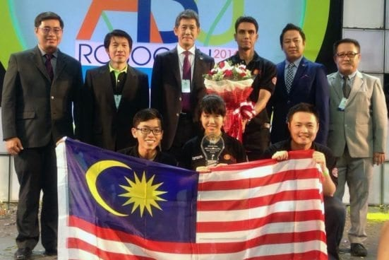 Dr. Ridzuan Ahmad (standing third from right) with UTM team after the closing ceremony of ABU ROBOCON 2016 at Bangkok, Thailand