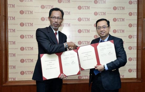 Abu Talib (right) exchanging documents with Prof. Fazi after the ceremony held at UTM Johor Bahru