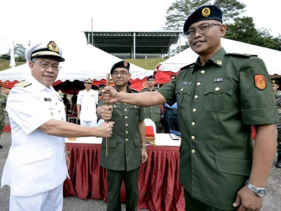 Prof. Alias (left) handing over the golden baton as symbol of authority as PALAPES Deputy Commander to Dr. Mohd Noor Ali Khan at handover ceremony held at PALAPES UTM