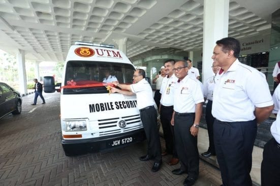 Prof Wahid (most left) cutting ribbons as symbol of launching the new UTM Security Division Mobile Station vehicle