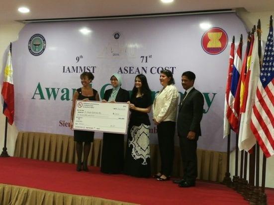 Prof Sharifah Rafidah (second from left) receiving .....