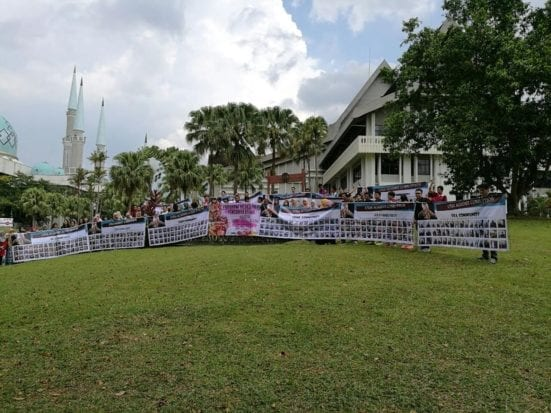 The Secreteriat of Corruption Prevention of UTM holding giant banner to support the Anti-Corruption campaign
