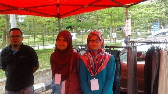 Siti Norazrina (most right) standing in her own stall at FKA Car Boot Sale.