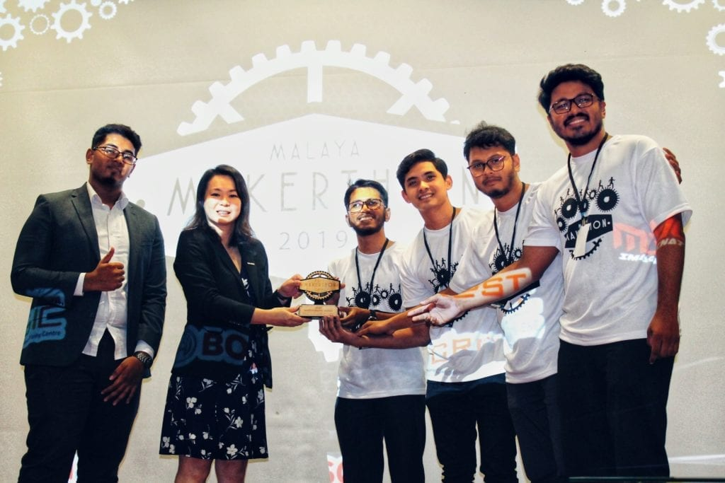 "The team receiving ""The Most Hard Working Team Award"" from the representative of Malaysian Global Innovation & Creativity Centre (MaGIC)."